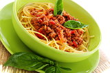 Pasta with tomatoes, meat and basil.