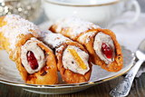 Roll with cream and candied fruit.