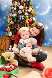 Christmas - happy young woman with a child.