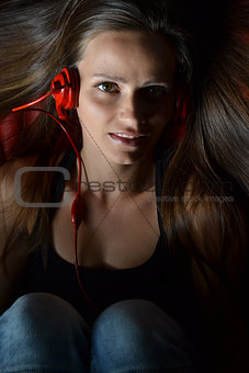 beautiful young woman listening music
