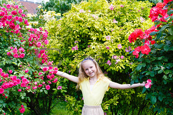 Portrait girl and rose bushes