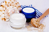 face cream in jars with sea salt and shell