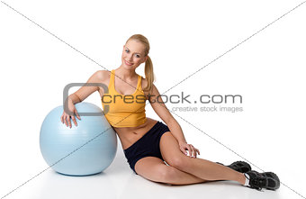 blond woman in fitness dress sitting