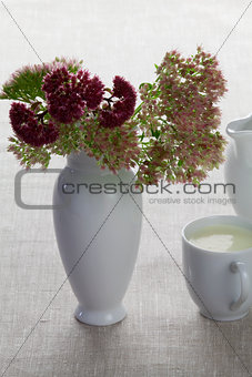 A cup of milk and autumn flowers