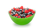 Fresh blueberries and raspberries in a green bowl