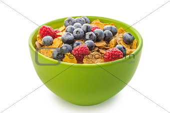 A bowl of cereal with raspberries and blueberries
