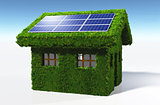 Grassy house with solar panels