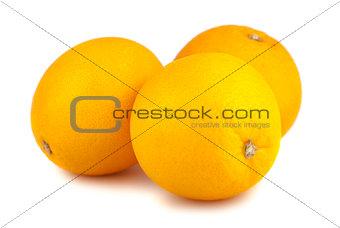 Three whole orange fruits