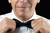 Man In Tux Straightens Bowtie, Two Hands