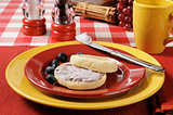 English muffin with blueberry cream cheese