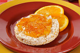Orange marmalade on a rice cake