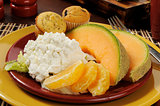 Cottage cheese with fruit and muffins