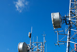 Telecommunication Towers on Blue Sky