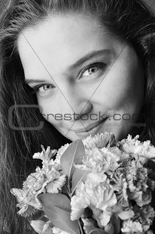 beauty young girl with blue eyes and flowers