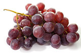 bunch of eating black grapes on a white background