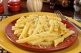 Buttered penne rigate noodles with parmesan cheese