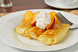 Cheese blintzes with peaches and cream