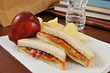 Peanut butter and jelly sandwich in a sack lunch