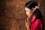 Myanmar girl in a praying pose.