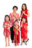 Asian Chinese family greeting on Chinese New Year