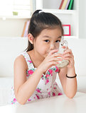 Drinking milk.