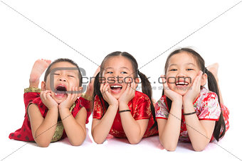 Asian children lying on floor