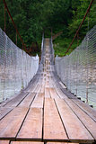 Suspension bridge across mountain river
