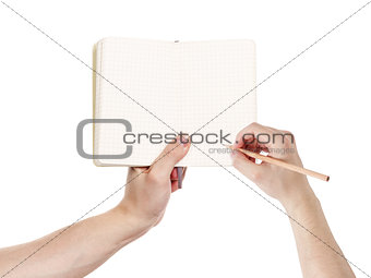 adult man hands writing something in notepad