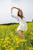 brunette woman in a yellow flowers field