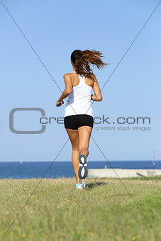 Back view of a young woman running