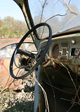 Rusty car at junkyard