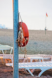 Lifebuoy hanging on a pole on the public beach.