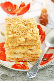 Cake of puff pastry with cream.