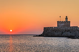 sunrise in Mandraki harbour. Rhodes, Greece