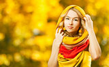 Blonde Woman in Yellow Hood on Autumn Background