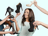happy woman with many shoes