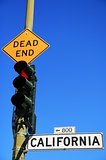 Red light at Dead End and California street traffic signs