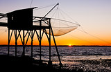 pier with fishing net during sunrise, Gironde Department, Aquita