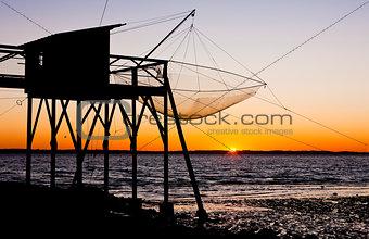 pier with fishing net during sunrise, Gironde Department, Aquita