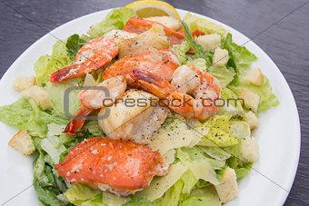Caesar Salad with Prawns Salmon and White Fish Closeup