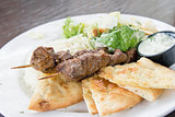 Lamb Kebab with Rice Naan and Salad Closeup
