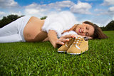 Pregnant woman lying on the grass