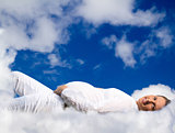Pregnant woman lying on clouds