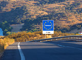 Road sign on the border, Spain