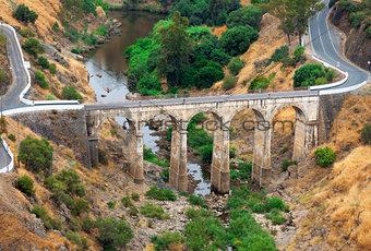 Arched road bridge