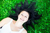 Beautiful girl lying on a grass