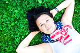 Beautiful girl lying on a grass