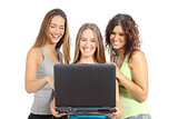 Group of teenager girls browsing internet in a laptop