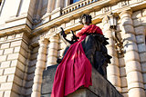 Statue near the Opera House in red cloth, Prague, Czech Republic
