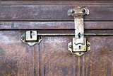 Lock of an old metal casket close up